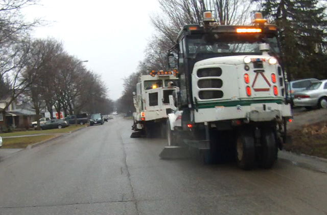Three street cleaners in action