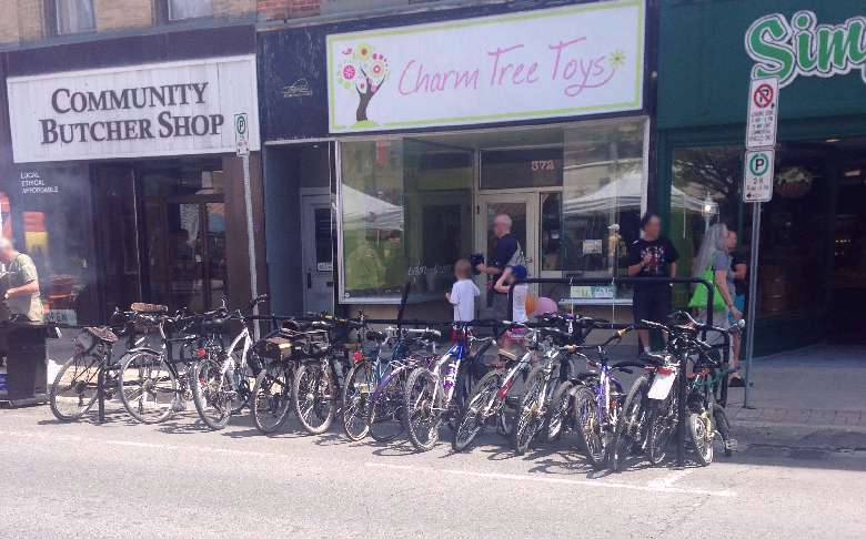Full bike racks on George Street during Peterborough Pulse event